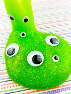My go-to easy Halloween monster slime recipe is a halloween activity favorite of my toddler boys and keeps them busy for hours. quick easy fall halloween googly eyes green monster slime recipe. a great halloween party diy, perfect for home schooling and weekend fun for toddlers, preschoolers and younger kids. science experiment