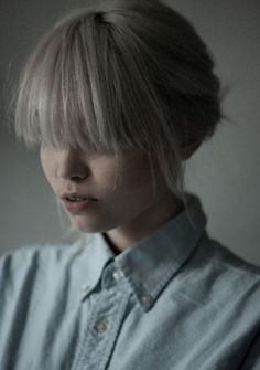 I'm cutting my bangs like this with the sides longer than the rest :)