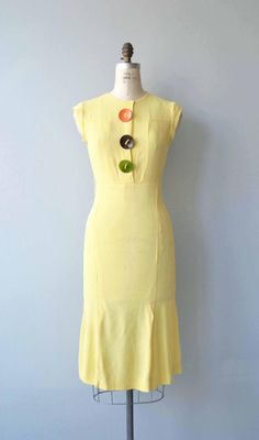 Vintage 1930s yellow silk crepe dress, sleeveless with large orange, green and brown enamel buttons, slightly elevated waist, bias construction, gusseted back and side closures. There are belt loops but no belt is present.  --- M E A S U R E M E N T S ---  fits like: small/medium bust: 37 waist: 28.5 hip: 33.5 length: 44 brand/maker: n/a condition: excellent  to ensure a good fit, please read the sizing guide: http://www.etsy.com/shop/DearGolden/policy ...