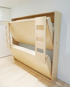 "{Double Murphy Bunk Bed for Kids} When folded, they become a small cabinet, only 14"" deep. Designed to manage the weight of two adults. Built-in ladders double as leg supports. Standard Twin: 80"" long x 14"" deep (when folded) x 85"" ht. For use with twin size mattresses (38"" wide x 75"" long x 6"" thick). Mattresses not included. Compact Twin (31"" x 75"" custom mattress)"