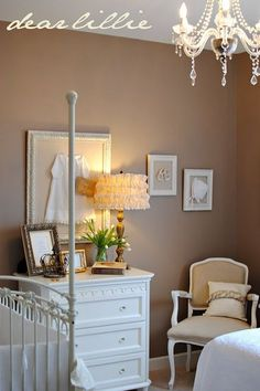beige and white nursery, love the framed gown, love the dresser and the colors