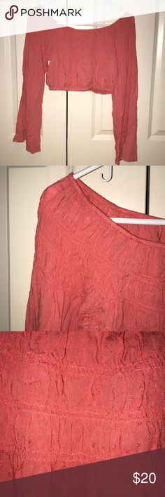 Flowy off-the-shoulder top Coral/ pink off the shoulder top from urban outfitters with flowy, bell bottom long sleeves and and has an elastic waistband on both the top and bottom. It's an XS but it could practically fit a up to a medium really just depending on your cup size. Super cute design on the front and it's perfect for festival season 🌞🍄💫 Pins & Needles Tops