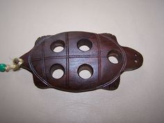 Hand carved walnut loading block is long & wide. Block is carved folk art style in the shape of a turtle.