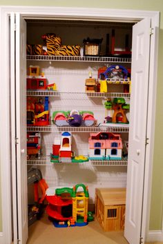 consider moving games to office closet and doing up the games closet like this for little people etc. Then legos, playmobil, and dolls can go on ivan shelves in tin bins.