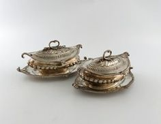 A pair of George III silver sauce tureens, covers and stands,  by Thomas Heming, London 1769.
