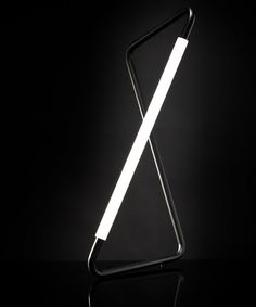 Minimalist black LED lamp. I love the way this looks. It's super modern and clean.