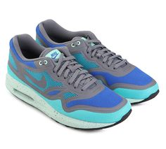 Air Max Lunar1 Breeze Running Shoes. Bursting with bright color, blue and gray upper, breathable mesh and stylish tape construction also aid the upper, by way of gray contrast surrounding the toe, paneling, lace collar and Swoosh branding.    http://www.zocko.com/z/JGrPY