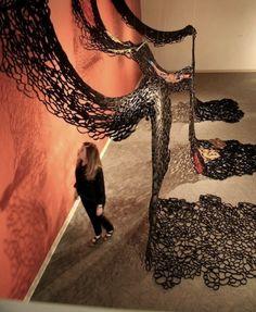"Suzan Shutan, artist, tar paper & handmade paper,exhibit ""Watered Down"", Norfolk Art Center, NE 2012"