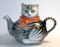 .Grey Cat Teapot  www.sallymeekinsceramics.co.uk  A full sized 1 litre Novelty Teapot of a Grey Cat Hand painted with modelled pink ribbon around neck of teapot Food safe glazes not dishwasher