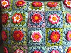 She attached the crocheted flowers to a granny square.  Love her color choices