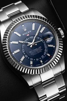 "The latest member of the Rolex family is an absolute overachiever! The Sky-Dweller is considered the brand's most complicated wristwatch and features a second time zone, a Saros annual calendar, a date window at 3 o'clock and the typical 100-metre water resistance of Rolex. In addition, the Sky-Dweller's calendar and complications can be set via the so-called "" ring-command bezel"". This turns it not into a sophisticated instrument that is at the same time infatuatingly beautiful."
