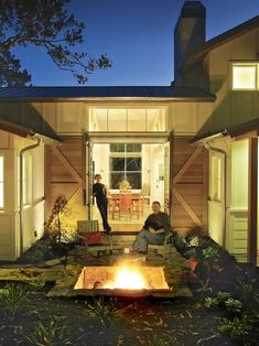 Modern Farmhouse...outdoor fire pit with sliding barn doors. Use those to close off back patio?!!!