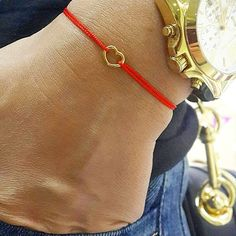 Cord bracelet heart-shaped with a word Love written on a front side and an arrow on a backside and Snake pendant - a well-known symbol of wisdom and initiation.