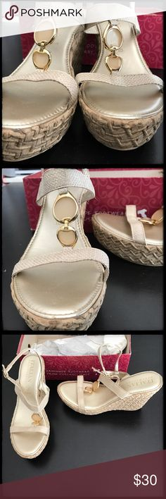 """Italian Shoemakers Platform Sandals Brand new! Annalies style by Italian Shoemakers. These size 10 (41) sandals fit short...probably more like a 9, which is why I'm selling them. 1.5"""" platform, heel reaches 4.5"""" in the back. Length inside is almost 10.5"""". These are beautiful tan shoes with a subtle jewel-like accent in front and a woven pattern that won't fray like cotton. Perfect with dresses, shorts, capris and jeans. Box does not have the top. Non-smoking home. No tags came attached, but…"""