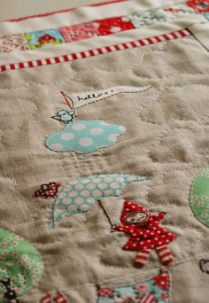 today was a cloudy grey day, which was fitting since I've just finally finished quilting this mini with lots of tiny little stitches... and all these fluffy clouds.