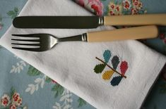 Using soluble canvas to cross stitch onto plain napkins.