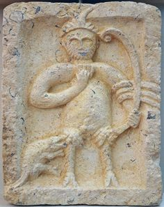 The double-horned god Silvanus (with iconography of Pan) holds a panpipe or syrinx in his right hand and a bow in his left. Over his elbow (ancon) he has draped most certainly a shawl or cloth. A quadruped seems to bit him in his thigh. Silvanus, horned god (Pan) [2nd-3rd century AD] - Split, Archaeological Museum - wm