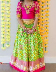Neon green ikkat silk kids lehenga with pink printed border, Paired with contrast elbow length sleeves blouse in pink color Frocks For Girls, Dresses Kids Girl, Kids Outfits, Kids Indian Wear, Kids Ethnic Wear, Kids Lehenga Choli, Anarkali Dress, Kids Blouse Designs, Kids Frocks Design