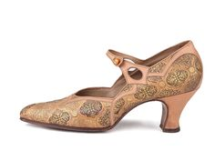 Louis heels strapped pumps with gold printed leather upper.