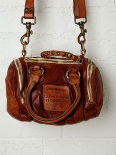 Most adorable little duffle/satchel ever.  If only I had an extra $348