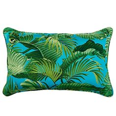 Transform your backyard into a tropical oasis by adding a Back Bay Ocean Indoor/Outdoor Throw Pillow to your favorite lounge chair. Bright green palm leaves pop against a turquoise ground reminiscent of the sea to turn up the heat on your patio's décor.
