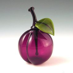 """""""Plum perfume""""    Art Glass Perfume Bottle    Created byGarrett Keisling         Plum scent bottle is carefully crafted by hand from rich violet colored glass and is individually mouth-blown and sculpted at the torch. These tiny treasures are fun, functional and collectible."""