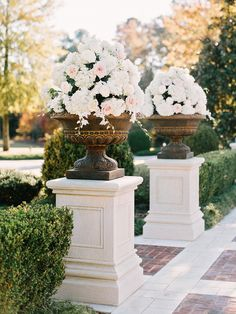 White Roses in Copper Painted Urns on White Pedestals. ::  Photography: Amy Arrington Photography - amyarrington.com  /2014/09/22/autumn-atlanta-estate-wedding/