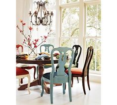 I love that the chairs don't match. I'm thinking of doing this in my dining room. Either same style with different colors or same color with different style.