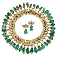 EMERALD AND DIAMOND NECKLACE, INDIAN, CIRCA 1900.  Designed as a fringed collar of  foliate design, decorated with rose-cut diamonds in a kundun setting, supporting a graduated fringe of emerald cabochon drops, together with a pair of matching earrings and an alater attachment, French,  length approximately 310 mm, case signed J. Chaumet, Sr de Morel and Cie, London, New Bond Street, 154, Paris, Place Vendôme, 12.