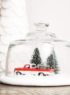A $5.00 thrifted glass cloche gets turned into the perfect vintage Christmas snow globe! www.littlehouseoffour.com