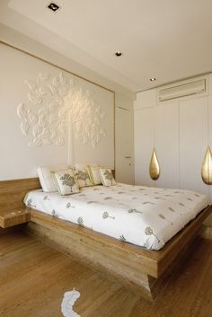Check out this bedroom by designer Ashiesh Shah where the leaf motif is echoed on the wall, duvet and even the floor!