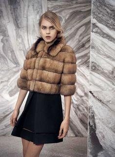 A beautiful woman wearing fur.