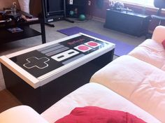 Nintendo NES Controller Glass Top Coffee Table by tmemmerson so cute for a game room or little boys room