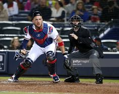 Catcher Tyler Flowers #25 of the Atlanta Braves chases a wild pitch while home plate umpire Mike Muchlinski #76 looks on during the game against the St. Louis Cardinals at Turner Field on April 8, 2016 in Atlanta, Georgia.