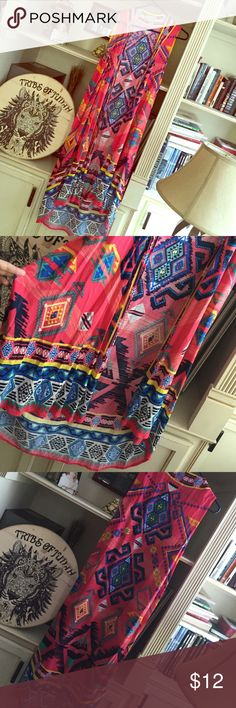 Beautiful Aztec Kimono Bright beautiful sleeveless kimono. Excellent condition! Measurements upon request. Flying Tomato Tops Tunics