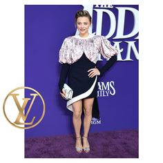 """in a look by at """"The Addams Family"""" premiere in Los Angeles. The Addams Family, It Bag, Emma Chamberlain, Jessica Biel, Chloe Grace Moretz, Justin Timberlake, Nicolas Ghesquiere, Louis Vuitton, Hoodie"""