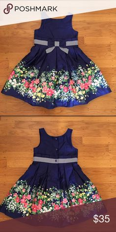 Janie and Jack dress Navy blue dress with multicolor pink floral print and striped bow ribbon trim.  Pleated full skirt.  NWOT.  Perfect for a birthday party, wedding flower girl, or summer BBQ! Janie and Jack Dresses
