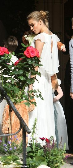 Cara Delevingne chooses sister Poppy's wedding to unveil new neck tattoo | Looking gorgeous and chic | Mail Online