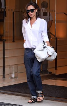 Victoria Beckham wearing Victoria Beckham Flat Top Sunglasses, Celine Fall 2016 Hiker Flat Sandals, Victoria Beckham Long-Sleeve Button-Front Tuxedo Blouse and Victoria Beckham Boyfriend Jeans Victoria Beckham Jeans, Victoria Beckham Style, Victoria Beckham Sunglasses, Mode Outfits, Casual Outfits, Fashion Outfits, Pink Outfits, Donna Karan, Boyfriend Jeans