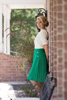 This kelly green skirt is simply beautiful! Features side pleats and gold button accents on one side.  Modest Skirts: Pleated Skirt in Kelly Green