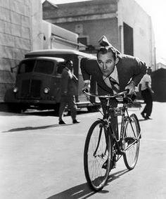 Bing Crosby rides a bike.  Tags: Bing Crosby bicycle
