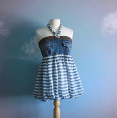 Blue jeans and a blouse become a dress or babydoll top.