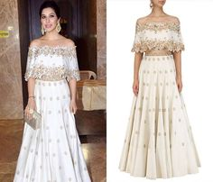 GET THE LOOK! Sophie Choudry paints a pretty picture in this Ivory Off Shoulder Cape with Lehenga Set from d&n by Dheeru and Nitika. Shop now! #dheeruandnikita #celebcloset #getthelook #sophiechoudry #elegant #lehenga #ivory #offshoulder #cape #blouse #white #golden #floral #indianfashion #bollywoodfashion #happyshopping #shopnow #perniaspopupshop #fashion2018