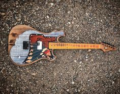 Guitar built by hand by Beau Theige and leather pick guard by Jimmy Compton  #customguitars #handmade #guitar