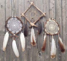 Gypsy Love' - Wood Vine Dreamcatcher simply adds a rustic, boho chic touch to any room!   Handcrafted with wood vine and sinew, this Dreamcatcher features a lovely crocheted doily and wild turkey feathers.
