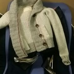Hollister gray button up sweater/cardigan xs This cardigan has 4 buttons that are dark brown.  The sewing has red which offsets the gray.  This is very warm and had been worn one time!  Sleeves roll up and there are 2 pockets.  Great condition! Hollister Sweaters Cardigans