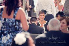Wedding guest portrait photograph with fascinator at Sandbanks Hotel Wedding. Photography by one thousand words wedding photographers