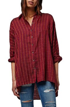 Casual meets trendy in this cotton shirt cut in an oversize fit with roomy dropped shoulders and a split high/low hem from Topshop.