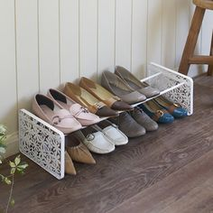 Powder coated steel stacking and extending shoe rack with floral ends