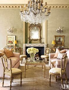 Sofas clad in a cotton silk from Lee Jofa are grouped with a Nancy Corzine cocktail table in the home's music room.